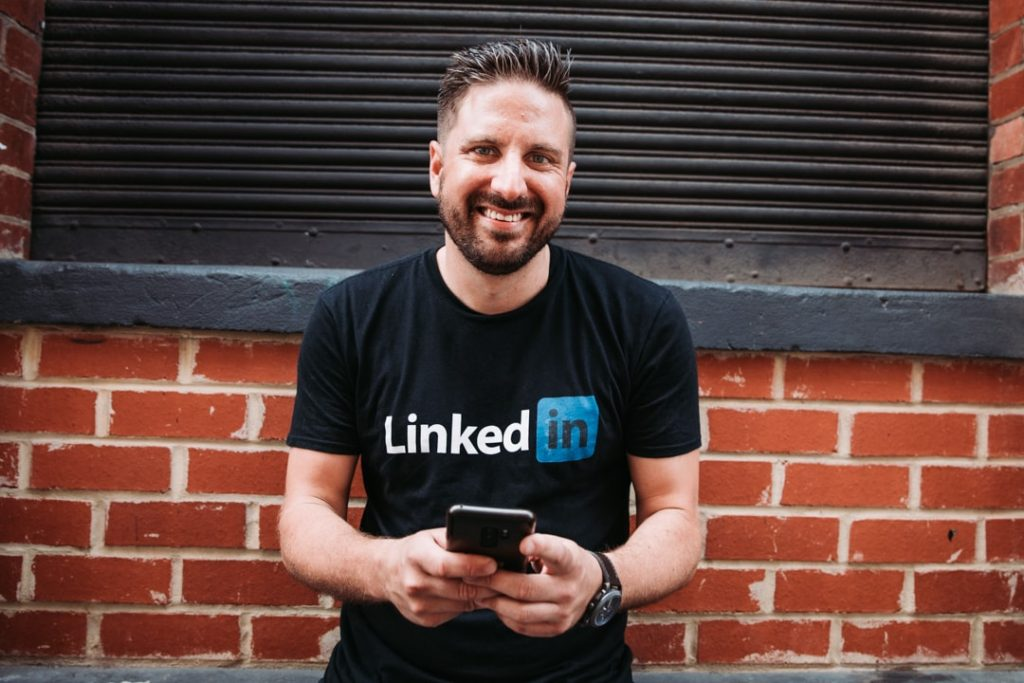 Nathaniel Bibby posing with a LinkedIn shirt on as a example of personal branding photography