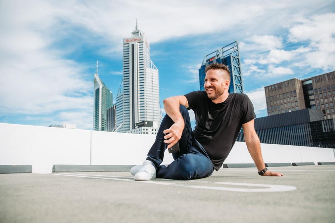 Nathaniel bibby sitting on a carpark rooftop